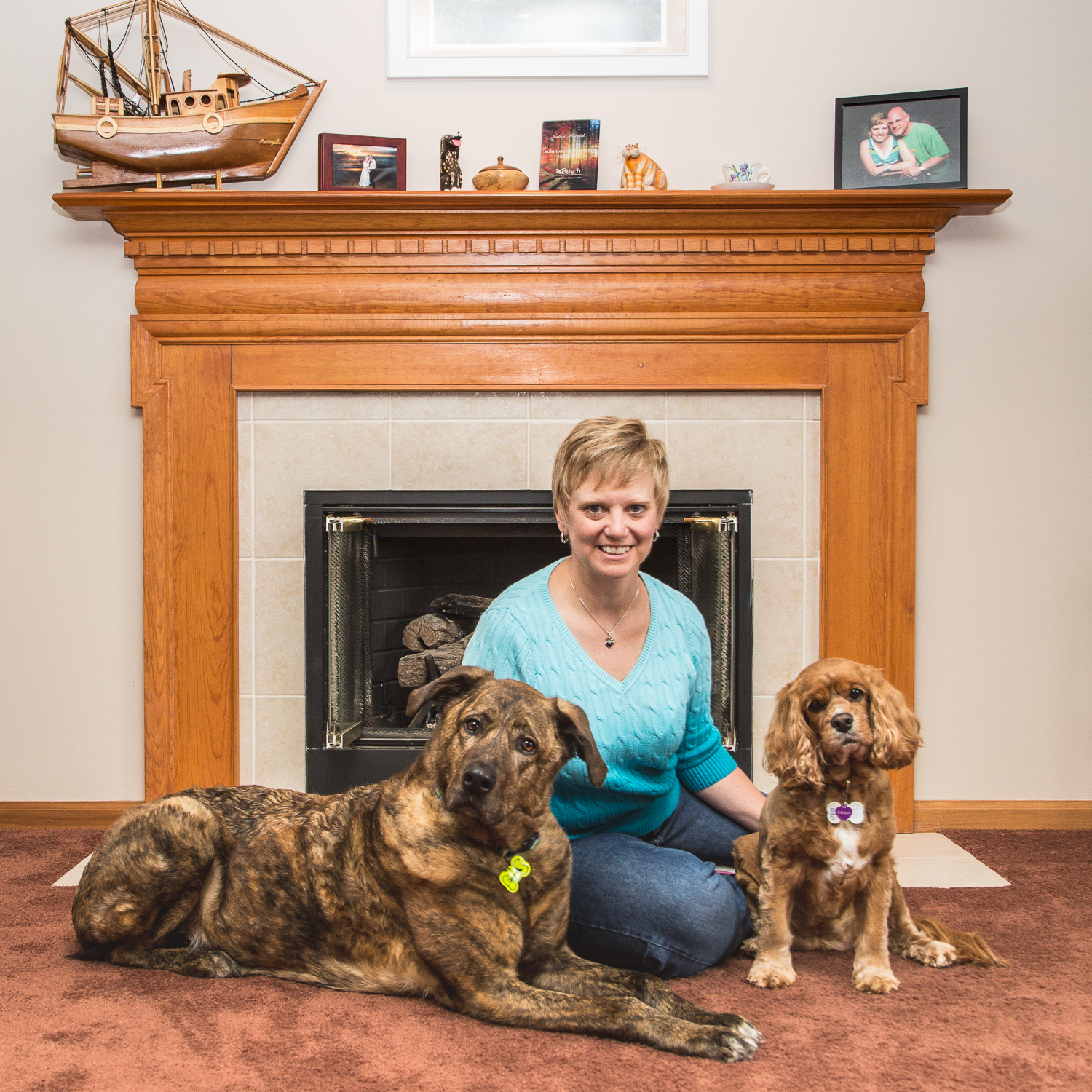 Cathleen Mutnick posing with her dogs