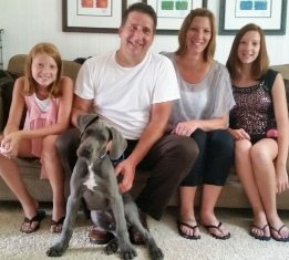 Family photo posing with their dog
